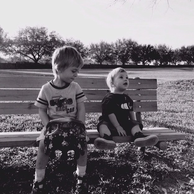 Brothers on a park bench
