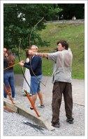 Илья пробует свои силы в стрельбе из лука.