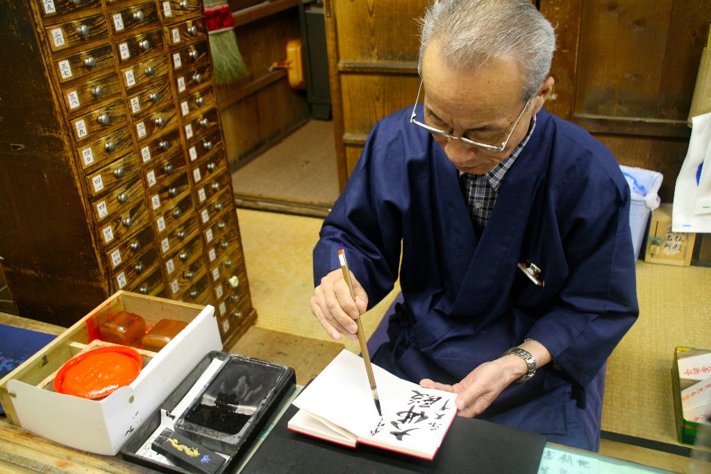 Calligraphist inside Todaiji Temple
