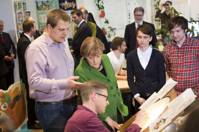 CEO und Co-Founder Jens Begemann bei einem Besuch von Bundeskanzlerin Angela Merkel.