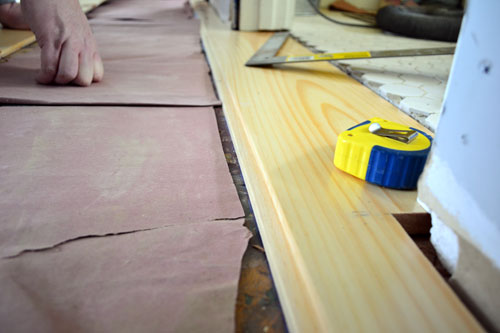 Cutting And Laying First Plank