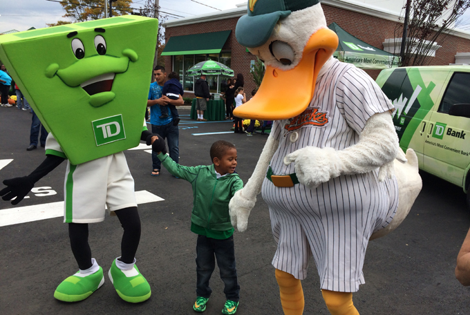I'm pretty sure there's a teller in that TD mascot suit, reevaluating his life choices. [Photo courtesy of liducks.com]
