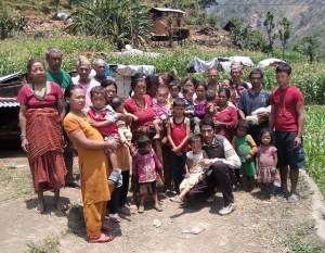 G.P. Dahal (front row, kneeling) with a highlands family whose animals his team assisted.