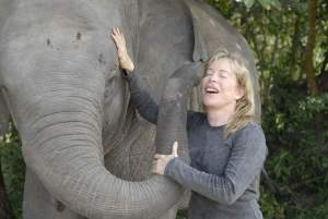 Wildlife Alliance founder Suwanna Gauntlett, shown with elephant, campaigns against the civet coffee industry. (Wildlife Alliance photo.)