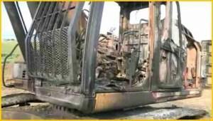 Burned equipment at Dakota Access site in Iowa. (From WHOTV video.)