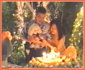 Crown Prince Vajiralongkorn and the Crown Prince's third wife, Princess Srirasm, feeding birthday cake to Fufu the poodle.