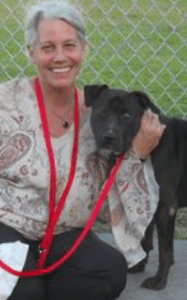Beth Clifton & Buddy the One-Eyed Pirate, a rescue dog she transported.