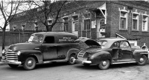 """The state-of-the-art Spokane Humane Society motor pool in 1949.  The sedan in front,  used for emergency animal pick-ups,  featured an on-board """"lethal chamber,""""  opened for display."""