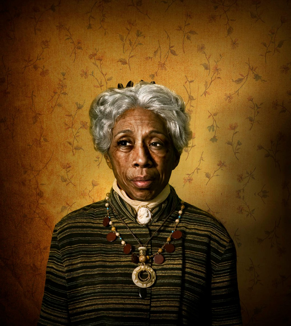 Aunt Esther, a chracter from AUgust WIlson's cycle of plays is portrayed as an old black woman with gray hair, exotic necklaces, and modest, timeless dress with a cameo broach at her throat.