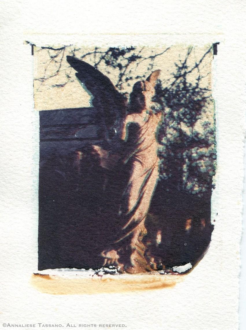 A broken stone cemetery angel in Kensall Green Cemetery. Polaroid transfer.