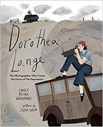 Cover of book shows Dorothea Lange sitting on top of a jeep with her camera.