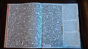 Black and white line drawings in style of Keith Haring