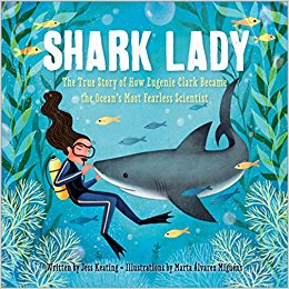 Cover of Shark Lady shows a woman in scuba gear underwater with a shark