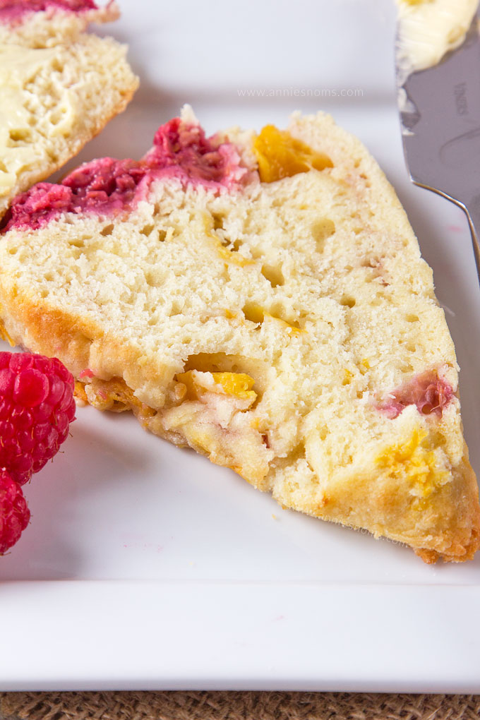 What is better than a fresh, homemade scone for breakfast? A homemade Peach and Raspberry Scone! Light, flaky, buttery and filled with fruit, these are the perfect start to your day!