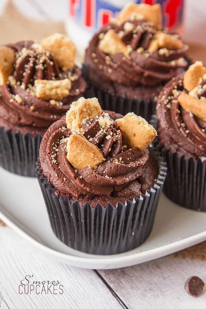 My S'mores Cupcakes are the perfect Summer treat in cupcake form! Rich chocolate cake, filled with marshmallow fluff and topped with velvety smooth chocolate frosting and crushed digestives.