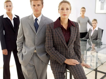 Business Executives Posing in an Office --- Image by © Royalty-Free/Corbis