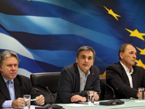 epa05255764 Greek Labour Minister George Katrougalos (L-R), Finance Minister Eucleidis Tsakalotos, and Development Minister George Stathakis during a press conference in Athens, Greece, 12 April 2016. The Greek government's negotiations with the institutions, formerly called the Troika, will resume after the end of IMF's Spring Meeting which is held from 15 to 17 April.  EPA/ALEXANDROS BELTES