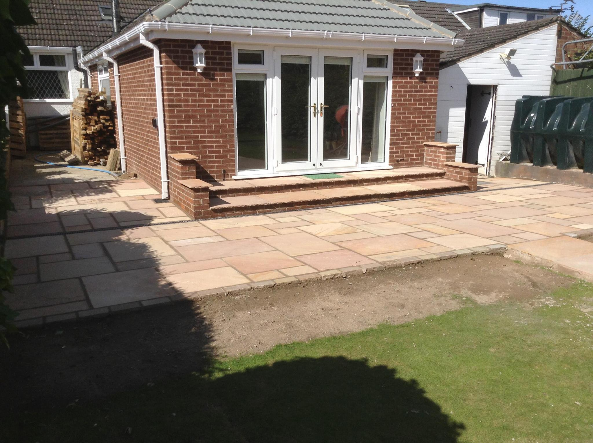 Patio gravel drain : Buff coloured indian stone patio with acore drains path