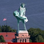 sandy wind blows statue of liberty