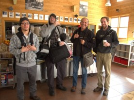 Eliott, Jason, Bella and Justin prepare for a weekend trip to Utah in the cafe