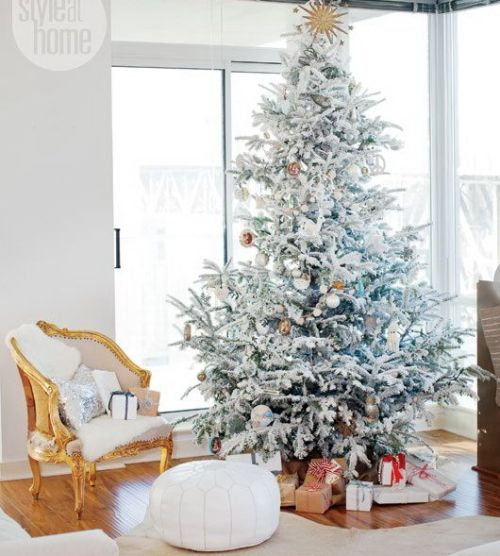 White upholstered ottoman and upholstered chair, white christmas tree