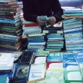 Vendor peddles his books at Vernisage, looking to eke out a living. (Photo by Tom Vartabedian)