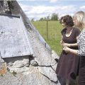 Skyrpuch recently traveled to Kapuskasing for more research. On this visit she says she discovered various artifacts, documents, and photographs from the era, adding pieces to the puzzle. In the photograph, she is seen reading a plaque in the cemetery that bears the names of all the people interned during World War I.