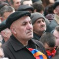 A man listens to Hovannisian during the rally at Freedom Square in Yerevan on Feb. 28. (photo by Khatchig Mouradian, The Armenian Weekly)
