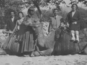 Nevart on a camel with a person identified as Mrs. Manooshag (Armenian teacher)