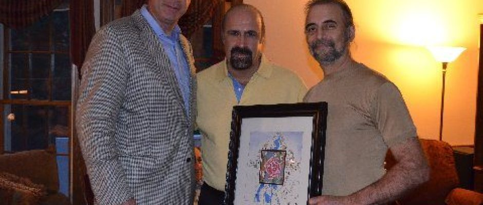 Sheriff Koutoujian, left, assumes his role as honorary chairman of the Merrimack Valley Armenian Genocide Monument Committee after a hectic day that saw him lead graduates of the Harvard University School of Government and rescue an assault victim in Harvard Square. Here he is joined by prominent Merrimack Valley artist Daniel Varoujan-Hejinian, center, and Carl Manikian.