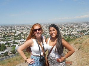 Victoria 'Tori' Kulungian (left) and Nairi Hovsepian appear right at home in Armenia overlooking the capital city of Yerevan, where they spent the summer on four work-related projects.
