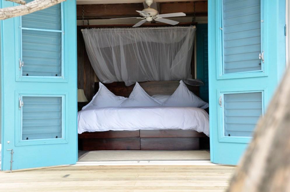 Oceanfront bedroom at Cayo Espanto, Belize