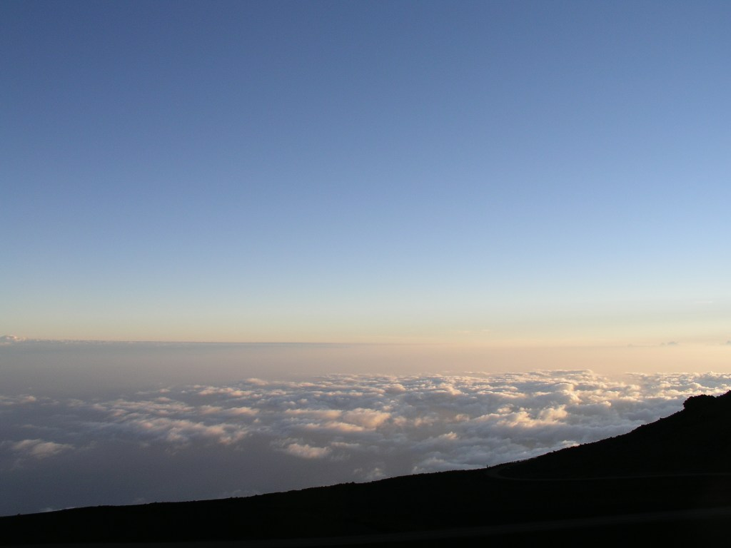 You're above the clouds when viewing the sunrise or set at Haliakala in Maui. Credit: Curt Woodhall, ArrivalsTravel.com