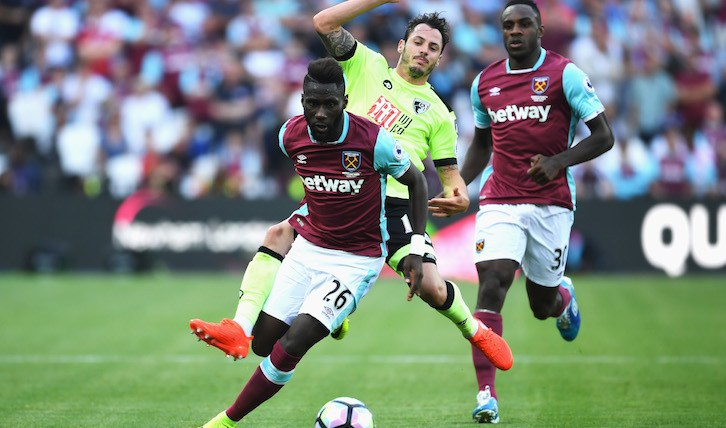 LONDON, ENGLAND - AUGUST 21: Arthur Masuaku of West Ham United is challenged by Adam Smith of AFC Bournemouth during the Premier League match between West Ham United and AFC Bournemouth at London Stadium on August 21, 2016 in London, England.  (Photo by Mike Hewitt/Getty Images)