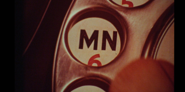 A close up of the letter M as seen on a telephone dial, (cine-real.com).