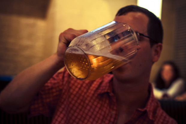 movie drinking games: Man drinking beer out of a pitcher.