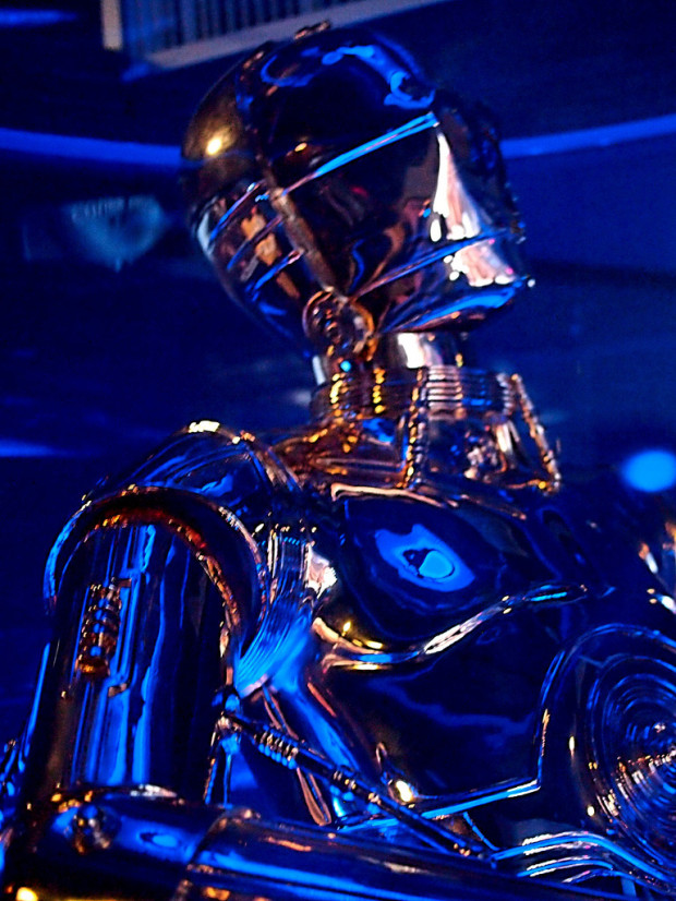 robots are coming to a rave near you! C3PO under blue light