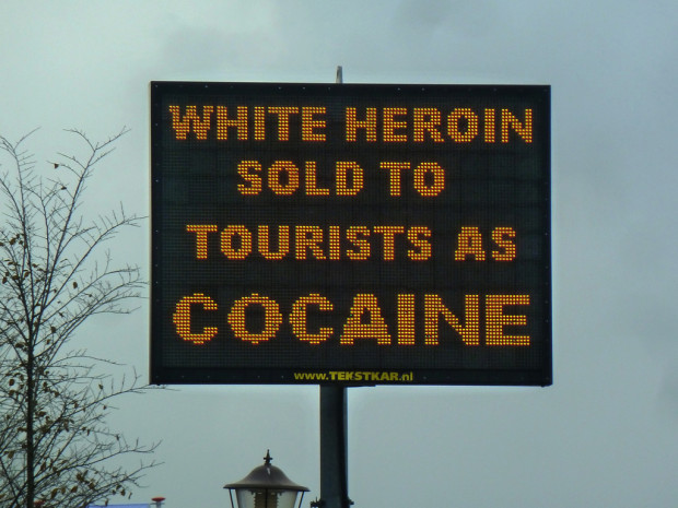 "worst drug dealers: Street sign reading ""White heroin sold to tourists as cocaine."""