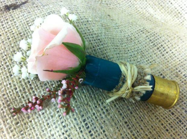 Flower shell: pink rose and baby's breath in blue shotgun shell