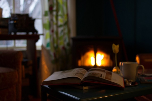 winter quotes: book on end table with fireplace in background