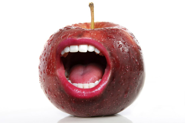 big oil: red apple with mouth on it