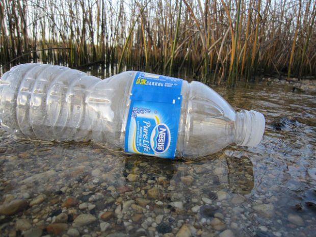 Water polluted with plastic water bottle
