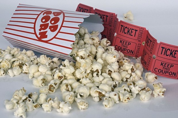 Photo of movie theater popcorn and tickets