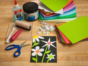 cut shapes out of sticky-back and textured foam sheets and adhere design onto a board