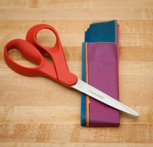 fold stack horizontally so that you leave a two inch space at top so you know where to fold over string
