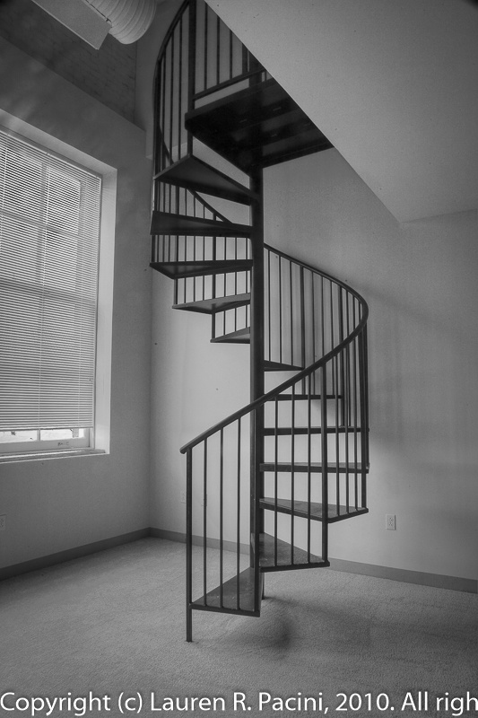 Spiral Staircase leads to Apartment's Second Story