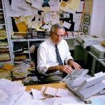 """Author David Halberstam works at his office in New York City on May 14, 1993. Halberstam, surrounded by research materials and word processing equipment, says he spent about six years researching his new book, """"The Fifties,"""" published by Villard Books.  (AP Photo/Mark Lennihan)"""