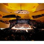 Musicians of the Orchestre de Paris perform during the gala opening of the Paris Philharmonie concert hall on January 14, 2015 in Paris. The Philharmonie, a multi-level concert complex whose main hall seats 2,400 on sweeping balconies surrounding the centre stage, took eight years and 386 million euros ($455 million) of public money to build -- a budget three times its initial estimate. AFP PHOTO / POOL / CHARLES PLATIAU