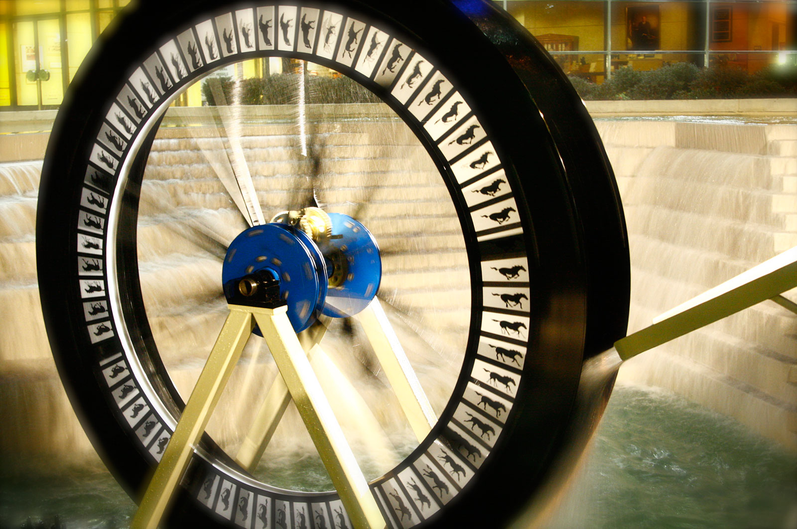 wheel with images being turned by water
