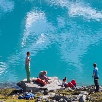 Beautiful setting in the Lyngen mountains. Stopping for a swim on our trek and navigation day. Photo: Jimmy Halvardsson